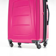 "Samsonite Momentum 20"" Hardside Spinner in the color Magenta."