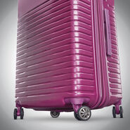 "Samsonite Spettro 25"" Spinner in the color Purple."