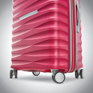 "Samsonite Voltage DLX 20"" Spinner in the color Pink."